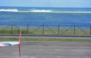 1424445456_surfing-di-airport-bali.jpg