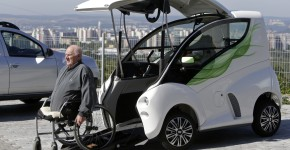 Trunda moves himself into his Elbee vehicle while seated on a wheelchair in Brno